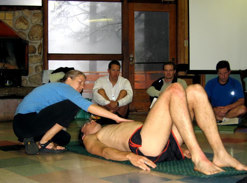 Scott demonstrates neutral pelvis with Leah