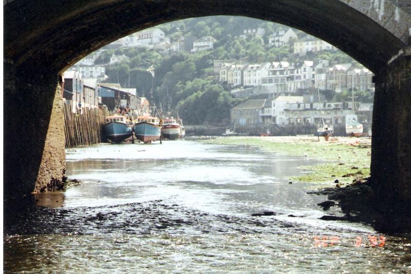 Looking under Looe bridge at low tide towards the sea.