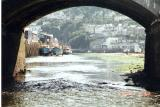 Looking under Looe bridge at low tide towards the sea.