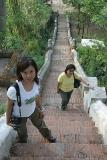 Joyce and Noon at stairs up Phu Si (Looking Down)