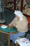 Demonstrating the ancient craft of lace-making