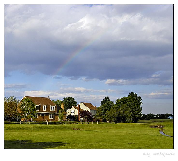 Suburb landscape with rainbow