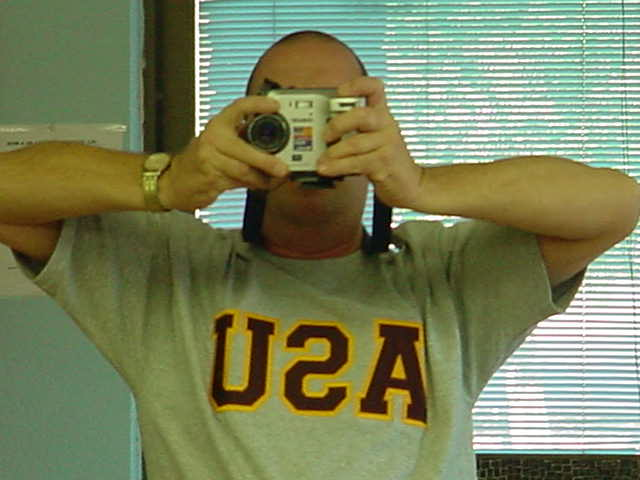 Jeffrey Lewis in his<br>USA - ASU t - shirt <br>taking a selfee