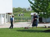 Amish Kids Mowing