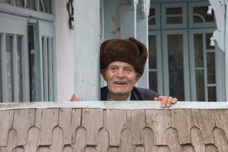 Old man at his house