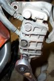 Then I removed the bolts on the rear of the caliper