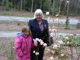 McKenzie and Janet Flick admiring the elepidote rhododendron 'McKenzie', named in her honor.
