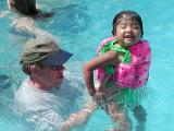 The Watermelon Girl and her dad play in the pool.
