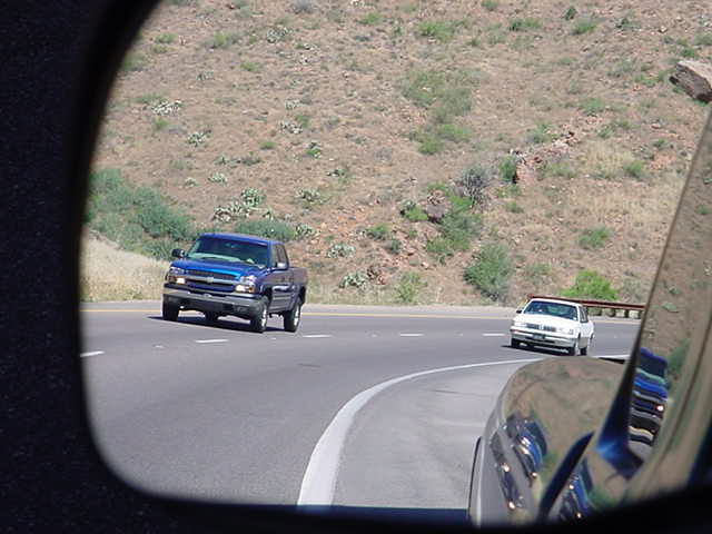 reflection of traffic approaching milepost 216 on the Beeline highway