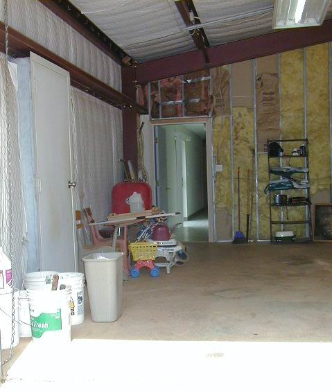 view from roll-up #2 along left side of garage into house entry
