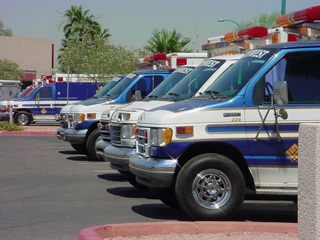a row of ambulances waiting to save lives