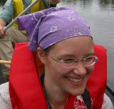 Janet in Canadian dress in a canoe on the Nyong River south of Mbalmayo