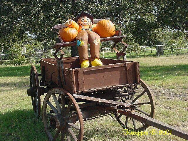 wagon and scarecrow