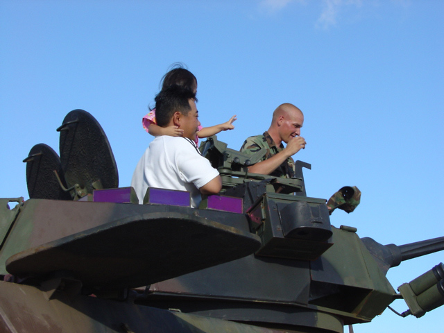 Family on LAV-25 (low res image)