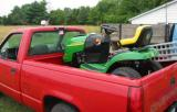 John Deere mower in truck, getting ready to be unloaded at it's new home