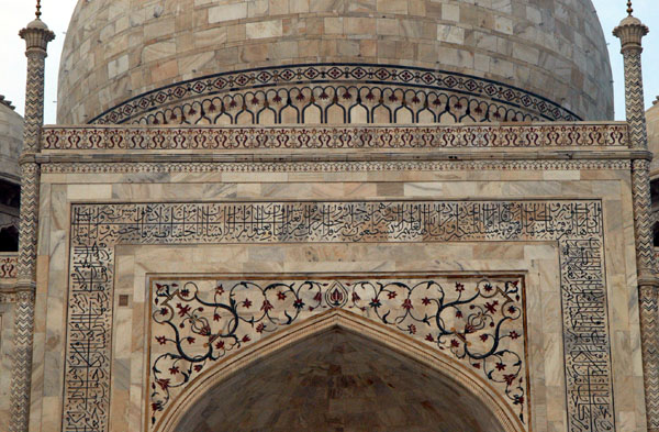 Intricate details cover the main mausoleum of the Taj
