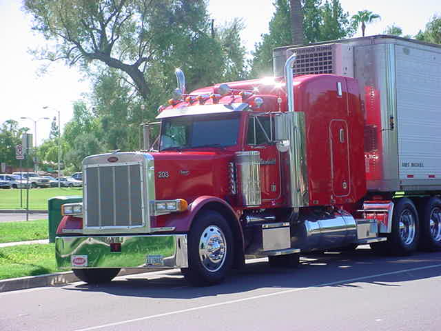 red & chrome big<br>rig on Center street