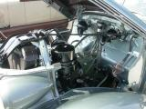 Engine compartment after.  Hood springs are cad (zinc plated)