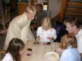 At the Aviemore time-share, Julie does card tricks, while Jake freezes