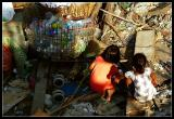 Kids playing in a garbage dump
