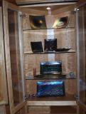 Corner display cabinet with McVay art glass collection. This is really beautiful irridescent glass, it just didn't photograph very well. Sorry! Kurt McVay is a local artist, received one piece as a gift and the rest is history.