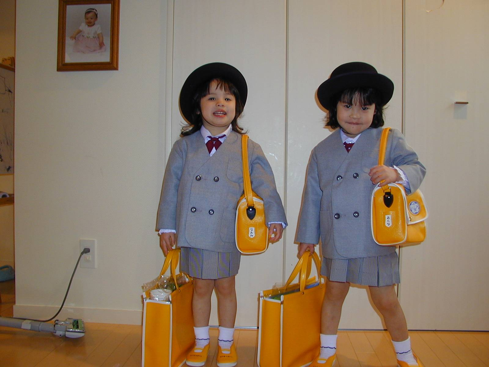 Naomi and Anna in school uniforms