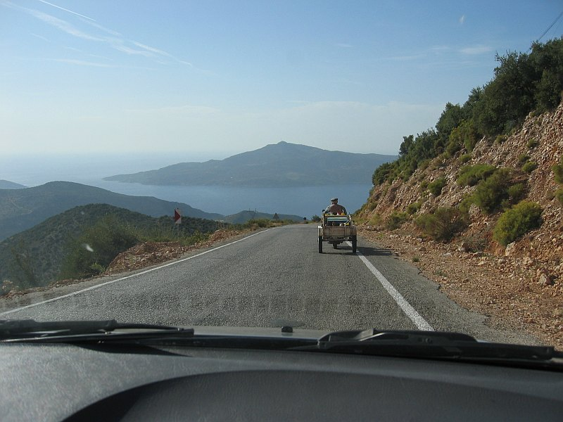 A local on motorcycle pulling cart tries to lead us to Bezirgan.