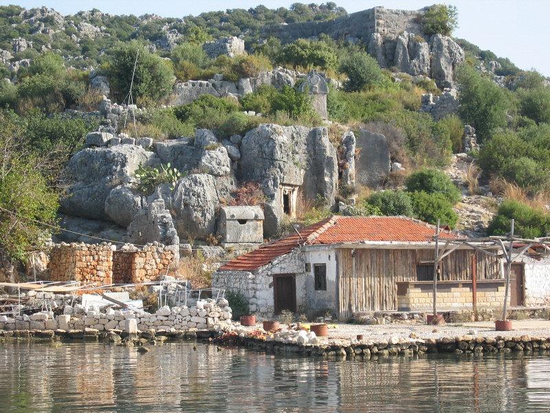 Near center, typical Lycian stone sarcophogi