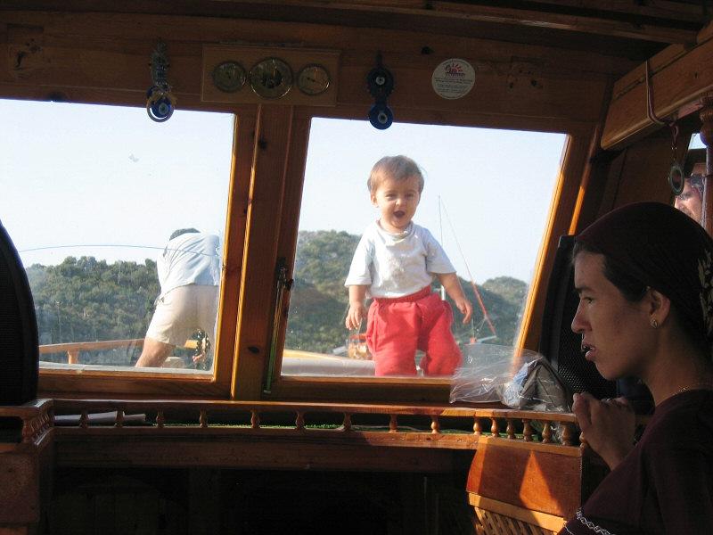 Delightfully happy boy belonging to one of the crew