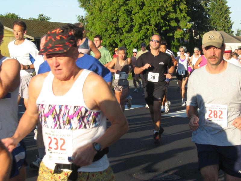 Marathon winner on far left<br>Mike Wakabayashi, Michael Dutton & Trish Hruby, center</br><br>Steve Yees face, far right</br>