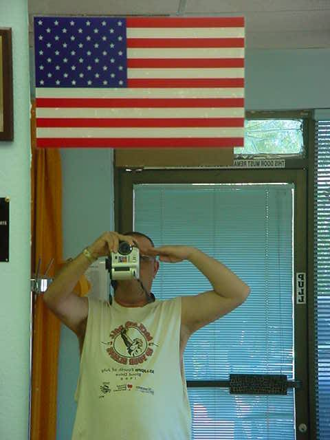 saluting the flag and taking the picture at the same time