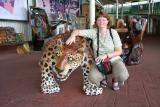 Angela with wood carving of a jaguar