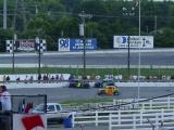 Legend cars tangle on back stretch