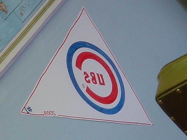 reflection of the Cubs banner at Bills barber shop
