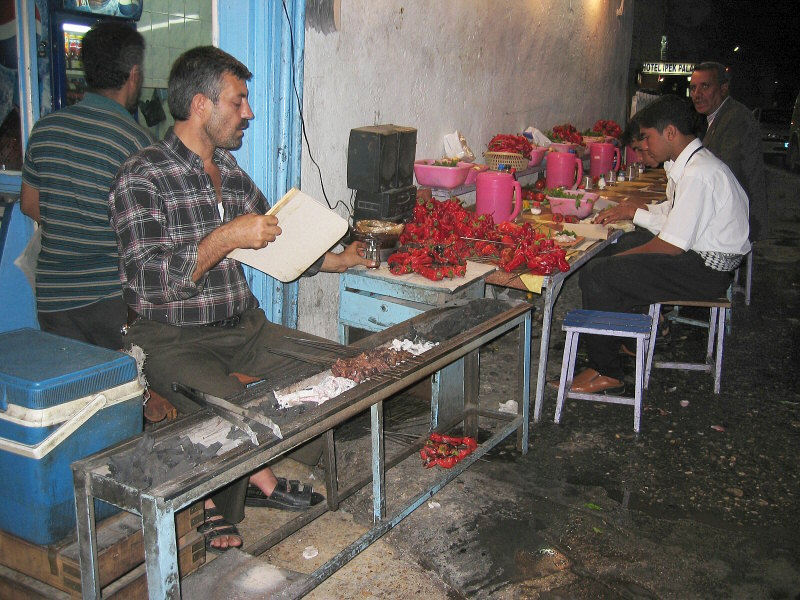 Street grillers, with Turkeys rich tomatos (and peppers?)