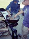 Frank Eatherly and Jason Ayers cooking beans. 2003