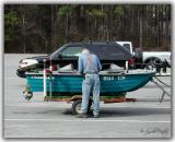 man-w-little-boat.jpg
