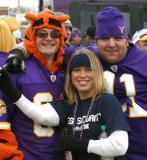 I don't know what a tiger has to do with the Viking Football team, but he is staying warm (and women are hanging out with him).