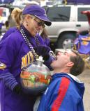 This NY Giants Football fan kicked a mini football through a goalpost and was given a shot of something for his effort.  This shows the hospitality of a Vking fan --- they will even feed a Giant.