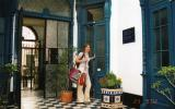 Meeli with a Bolivian bag in stylish hostel Roma in Lima, Peru