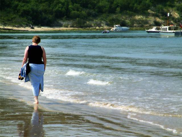 Carole walking in the shallows, Isle of Wight