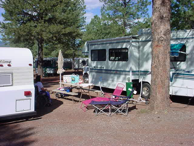 Tag-A-Long trailer <br> and neighbors at <br> KOA campground