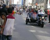 Leaning from the side of the side car
