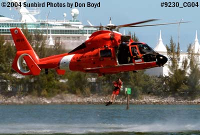 2004 - USCG HH-65B #6516 rescue swimmer jumping out - Coast Guard stock photo #9230