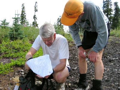 Kendall & Beast study the map