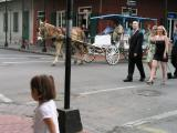 Horse-drawn carriage rides and Sarah dancing on Burbon Street
