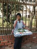 Boy selling cigarettes in front of the National Museum