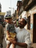 Man holding child, Dhaka