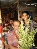 Man and boy at produce market, Dhaka
