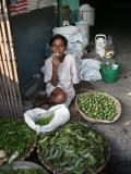 Boy snacking, produce market Dhaka